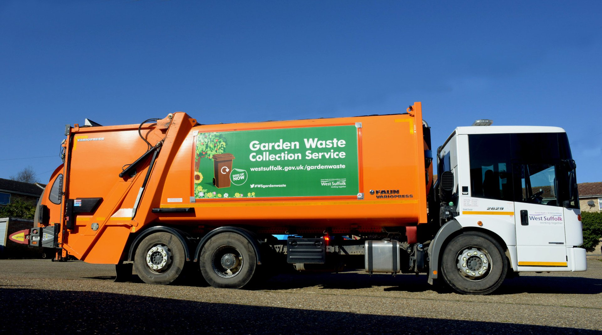 bin lorry collecting garden waste