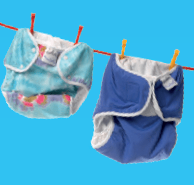 Two cloth nappies hanging on a washing line