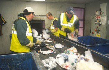 Men sorting out rubbish on a conveyor belt