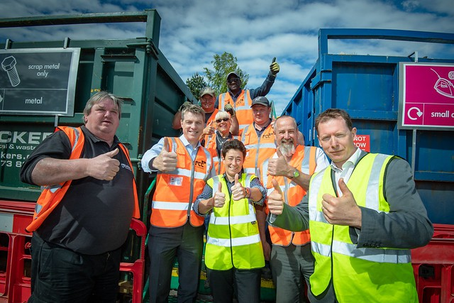 Staff at recycling centre giving thumbs up