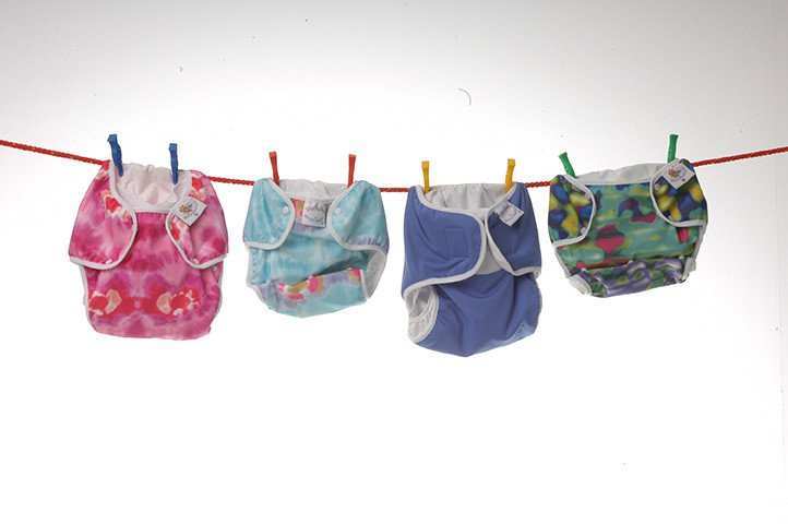 Four cloth nappies hanging on a washing line